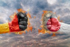 Two fist with the flag of Germany and Japan faced at each other. Ready for fight Stock Photos