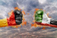Two fist with the flag of Germany and United Arab Emirates faced. At each other ready for fight Stock Photography