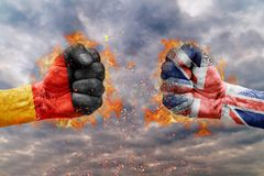 Two fist with the flag of Germany and United Kingdom faced. At each other ready for fight Stock Image