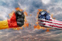 Two fist with the flag of Germany and USA faced at each other. Ready for fight Stock Image