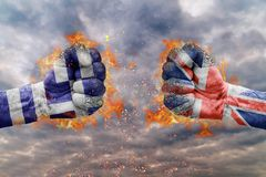 Two fist with the flag of Greece and Great Britain faced. At each other ready for fight Stock Photo