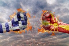 Two fist with the flag of Greece and Macedonia faced at each other. Ready for fight Stock Images