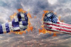Two fist with the flag of Greece and USA faced at each other stock image