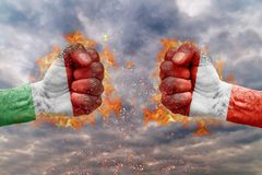 Two fist with the flag of Hungary and Austria faced at each other. Ready for fight Royalty Free Stock Image