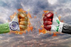 Two fist with the flag of India and Iraq faced at each other. Ready for fight Stock Images