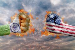 Two fist with the flag of India and USA faced at each other. Ready for fight Royalty Free Stock Images