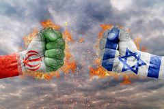 Two fist with the flag of Iran and Israel faced at each other. Ready for fight Royalty Free Stock Photography