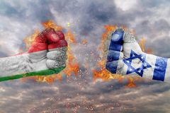 Two fist with the flag of Italy and Israel faced at each other. Ready for fight Royalty Free Stock Image
