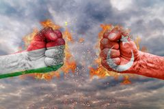 Two fist with the flag of Italy and Turkey faced at each other. Ready for fight royalty free stock image