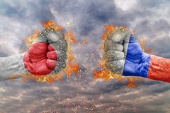 Two fist with the flag of Japan and Russia faced at each other. Ready for fight Stock Image
