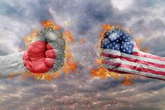 Two fist with the flag of Japan and USA faced at each other. Ready for fight Royalty Free Stock Photo