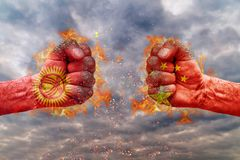 Two fist with the flag of Kyrgyzstan and China faced at each other Stock Image