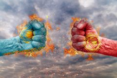 Two fist with the flag of Kyrgyzstan and Kazakhstan faced at each other Stock Photography