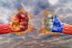 Two fist with the flag of Kyrgyzstan and Russia faced at each other Stock Photo
