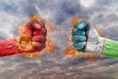 Two fist with the flag of Kyrgyzstan and Uzbekistan faced at each other Royalty Free Stock Photo