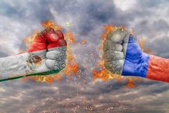 Two fist with the flag of Mexico and Russia faced at each other. Ready for fight royalty free stock photos