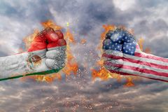 Two fist with the flag of Mexico and USA faced at each other. Ready for fight royalty free stock photos