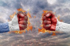 Two fist with the flag of Netherlands and Indonesia faced at each other. Ready for fight royalty free stock image