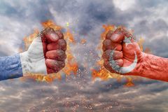 Two fist with the flag of Netherlands and Turkey faced at each other. Ready for fight stock image