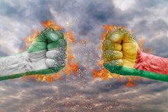Two fist with the flag of Nigeria and Benin faced at each other. Ready for fight Stock Photography