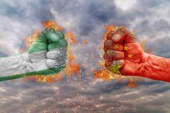 Two fist with the flag of Nigeria and China faced at each other. Ready for fight Stock Photography
