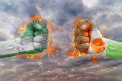 Two fist with the flag of Nigeria and Niger faced at each other. Ready for fight Stock Photo