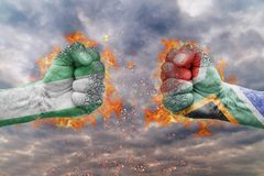 Two fist with the flag of Nigeria and South Africa faced at each other. Ready for fight Royalty Free Stock Images