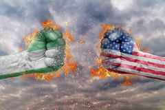 Two fist with the flag of Nigeria and USA faced at each other. Ready for fight Stock Image