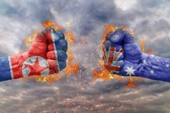 Two fist with the flag of North Korea and Australia faced at each other. Ready for fight Stock Images