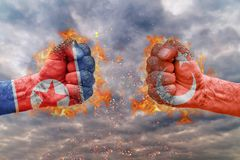 Two fist with the flag of North Korea and Turkey faced at each other. Ready for fight royalty free stock photography
