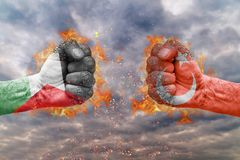 Two fist with the flag of Palestine and Turkey faced at each other. Ready for fight stock photo