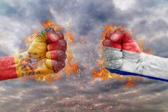 Two fist with the flag of Spain and France faced at each other. Ready for fight Royalty Free Stock Photo