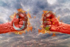 Two fist with the flag of Turkey and China faced at each other. Ready for fight stock images