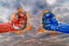 Two fist with the flag of Turkey and EU faced at each other. Ready for fight royalty free stock images