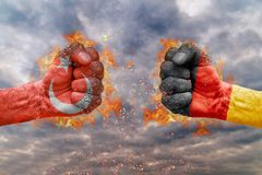 Two fist with the flag of Turkey and Germany faced at each other. Ready for fight royalty free stock image