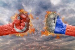 Two fist with the flag of Turkey and Russia faced at each other. Ready for fight stock image