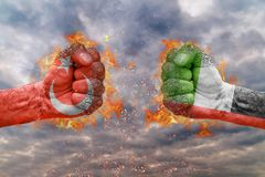 Two fist with the flag of Turkey and United Arab Emirates faced at each other. Ready for fight stock photo