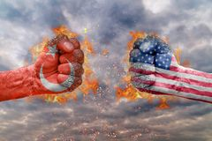 Two fist with the flag of Turkey and USA faced at each other. Ready for fight stock photo
