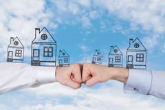 Two fist with houses Royalty Free Stock Photo