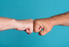 Two fists in confrontation Stock Photo