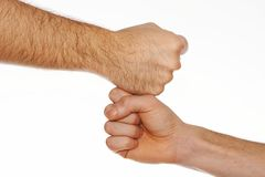 Two fists in contact. On white background Stock Photography