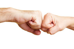 Two fists punching Royalty Free Stock Photo