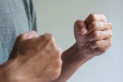 Two fists ready to fight. Man is acting in the fighting pose, two fist ready to fight royalty free stock images