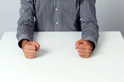 Two fists on a white table Stock Image