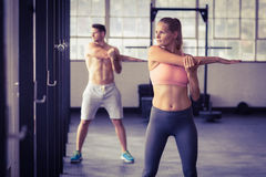 Two fit people doing fitness Royalty Free Stock Image