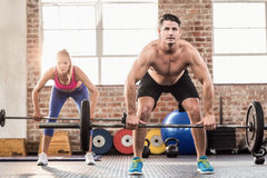 Two fit people working out Stock Image