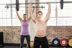 Two fit people working out Stock Images