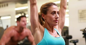 Two fit people working out at crossfit session Royalty Free Stock Photo