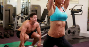 Two fit people working out at crossfit session Royalty Free Stock Images