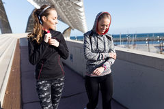 Two fit and sporty young women relaxing after work out in the pa Royalty Free Stock Photo